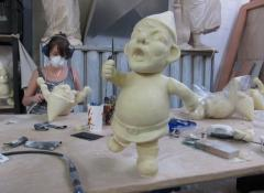 Cleaning seams on plastic cast gnomes, Fabrication South Africa